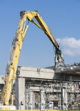 Demolition machine knocking down a bridge Royalty Free Stock Photos