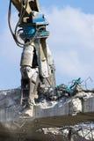 Demolition machine knocking down a bridge Royalty Free Stock Photography