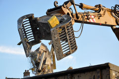 Demolition machinery. In action dropping building materials Royalty Free Stock Images