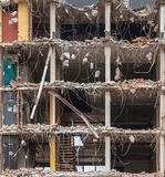 Demolition of a multi floor building. Demolition building background with Pieces of Metal and Stone are Crumbling from Demolished Building Floors Royalty Free Stock Photography