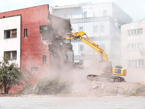 Demolition of old building. With bulldozer stock image