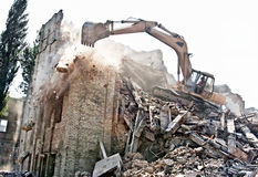 Demolition of old building. Excavator demolishing  of an old building Stock Photography