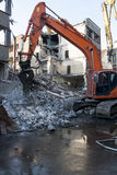 Demolition of an old building. With heavy machinery for new construction Stock Image