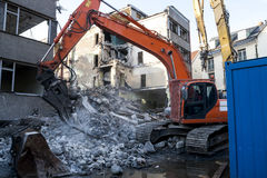 Demolition of an old building. With heavy machinery for new construction Stock Photo