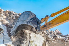 Demolition of an old house with excavator Stock Image