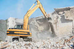 Demolition of an old house with excavator Royalty Free Stock Images