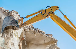 Demolition of an old house with excavator Royalty Free Stock Photo