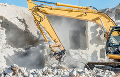 Demolition of an old house with excavator Royalty Free Stock Image