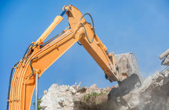 Demolition of an old house with excavator Stock Photo