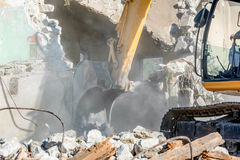 Demolition of an old house with excavator Royalty Free Stock Photography
