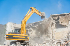 Demolition of an old house with excavator Stock Photos