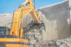 Demolition of an old house with excavator Stock Photography