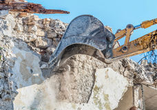 Demolition of an old house with excavator.  Royalty Free Stock Photo