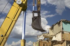 Demolition of an old house on the sky with clouds. Moscow, Russia.  Stock Photos