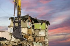 Demolition of an old house on the sky with clouds. Moscow, Russia.  Royalty Free Stock Photo