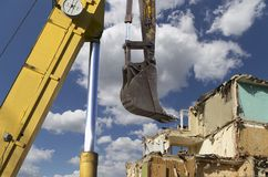 Demolition of an old house on the sky with clouds. Moscow, Russia.  Royalty Free Stock Images