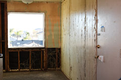 Demolition of paneling off interior wall Stock Photo