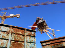 Demolition Recycling. Recycling the debris with an excavator when tearing down a house Stock Images