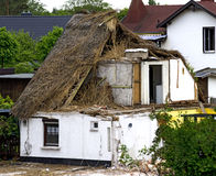 Demolition of a reed covered house Stock Images