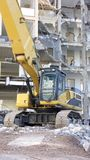 Demolition Site. Office Building in the City of Siegen Torn Down Showing the Facade and Rooms inside, Huge Excavator stock image