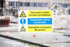 Demolition site building collapse hazard danger sign. Uk stock images