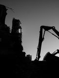 Demolition site at night. Demolition site in the evening with construction equipment in silhouette Stock Images