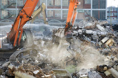 Demolition site. Of old factory building with heavy machines at work Royalty Free Stock Images