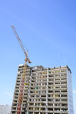 Demolition of a skyscraper with a high crane Stock Photo