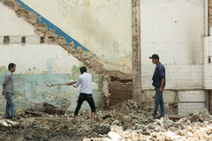 Demolition team. Demolishing old building in Ho Chi Minh city in District 1 in Vietnam Stock Photography