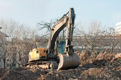 Demolition truck in action. Demolition of an old block of flats. Stock Photography