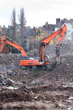 Demolition trucks in action. Demolition of an old block of flats. Royalty Free Stock Photography