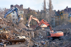 Demolition trucks in action. Demolition of an old block of flats. Royalty Free Stock Photo