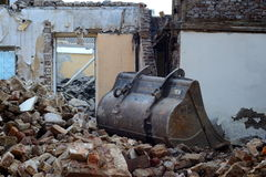 Demolition work. Demolish a house, rubble and scrapers Royalty Free Stock Photography