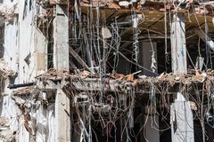 Demolition work of office building. A sunny day Royalty Free Stock Images
