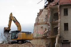 Demolition work old building with excavator. In the City royalty free stock photo