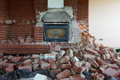 Demolotion of an old fireplace Stock Images