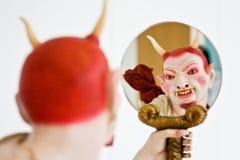 Demon. Face on white, close detail, focus on eyes Stock Photo