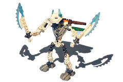 The demon. Bionicle two blades with a beautiful blue horns and wings ready to fight against evil and win Stock Photography