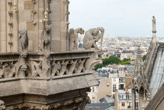 Demon, Dog, Heron and grotesque Gargoyles of Notre Dame Royalty Free Stock Photo