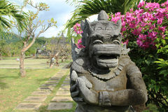 Demon gaurdian statue at Bali Temple in Indonesia. Stone carved demon guardian statue in Balinese Temple garden in Bali, Indonesia royalty free stock photo