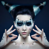 Demon girl with spikes on the face and body. Black eyes Stock Photo