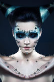 Demon girl with spikes on the face and body Royalty Free Stock Photo