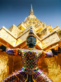 Demon guard is protecting the golden temple. This statue is guarding the Wat Phra Kaew -- Temple of the Emerald Buddha Stock Photo