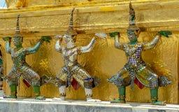 Demon Guardian/ Giant Statues stand around pagoda and hand to li Stock Image