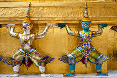 Demon Guardian golden Chedi at Wat Phra Kaew. An Yaksha supporting a golden Chedi at the Wat Phra Kaew Grand Palace temple in Bangkok, Thailand. Yakshas are Royalty Free Stock Photography