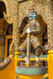 Demon Guardian near entrance in buddhist temple, northern  Thailand. Royalty Free Stock Photography