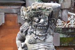 Demon guardian spirit house at temple entrance in Bali,Indonesia. Balinese demon spirit sculpted stone guardian outside temple entrance on Bali Island, Indonesia Royalty Free Stock Image