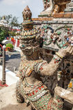 Demon Guardian statue at Wat Arun temple in Bangkok. Close up of demon guardian statues decorating the Buddhist temple Wat Arun in Bangkok, Thailand Stock Photography