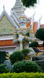 Demon Guardian statues in Wat Arun buddhist temple in Bangkok, Thailand Stock Photos