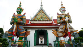Demon Guardian statues in Wat Arun buddhist temple in Bangkok, Thailand Royalty Free Stock Photo
